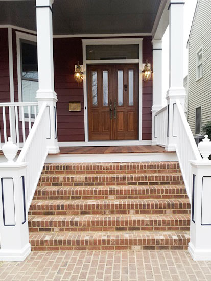front entryway, covered porch, brick stairs