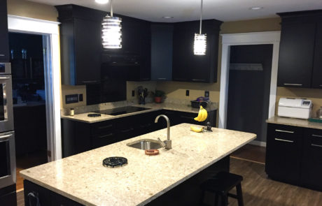 dark espresso kitchen cabinets with light granite countertops